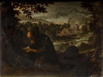 Franciscano en oración en el bosque