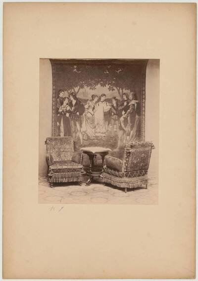Photograph of two period fauteuils with end table in front of a tapestry with a baptism scene with figures in historical Renaissance costumes (vom Bearbeiter vergebener Titel)