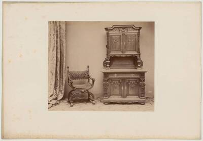 Photograph of a period armchair with a seat made of taught textile and a cabinet (vom Bearbeiter vergebener Titel)