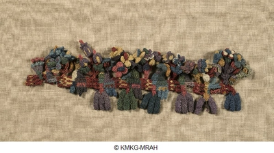 Fragment of a textile's edging embellished with birds