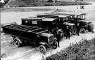 Vehicles from the Witheridge Transport Co. The solid tyred charabanc in front was used for outings. Each row of seats had its own door and a ladder was needed for passengers to get in and out. When it rained the hood at the back was passed contd./.
