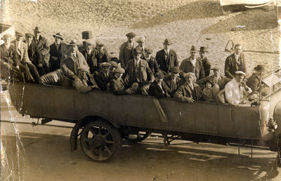 A charabanc outing, possibly a works group or working mens club.