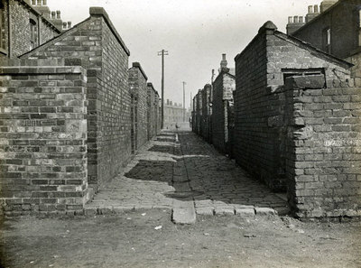 Timperley Street with a view of the back entry. They were demolished during the 1950s.