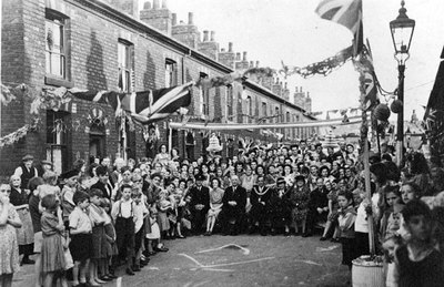 Celebrations for VJ Day in Marrabone, ie Bedford Street, Grove Street, Walmsley Street and part of Warrington Road. Present are the Mayor Richard Yates and Mayoress Mrs Yates.