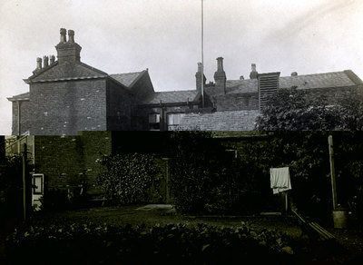 Garden at the rear of the Accident Hospital in St Marys Road. It was opened in 1878 and is being extended in preparation for the casualties of the First World War. Part of the Transporter Bridge can