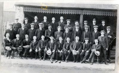 A group of men at the Widnes Bowling Club. The bowling club is situated in Milton Road behind the houses and extends up to the football ground.
