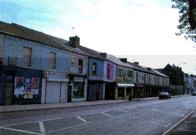 A row of restaurants facing Simms Cross School in Widnes Road.
