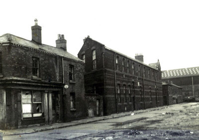 Margaret Street, Newtown. The derelict public house on the left was on the corner of Ann Street and Margaret Street. The middle building is the wall of St Maries Primary School. Infants - ground floo