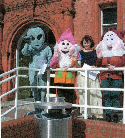 Exterior of Widnes library showing characters fron Snow White and the seven dwarves on World Book Day 2003.