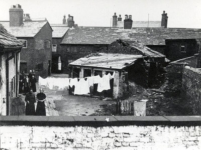 Backyards and outhouses in Appleton Village, Widnes. Probably washday.