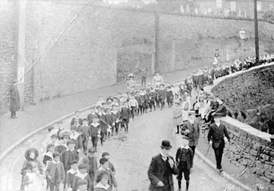 St Bedes Sunday School Procession walking down Deacon Road by Appleton Quarry Wall.