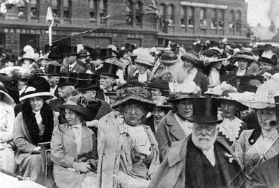 Crowd gathering outside the MArket Hotel and the Town Hall possibly for the visit of King George V.