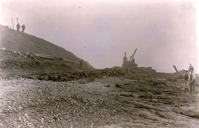The construction of the embankment between the river and Hutchinsons Tip near to the entrance to Ditton Brook.