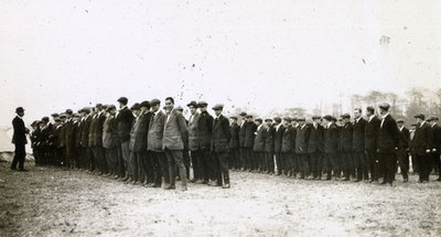Lines of new recruits in civilian dress