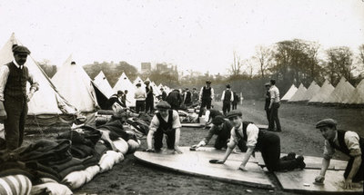 Men from the Pals Battalions building their own hutments or tents in Heaton Park