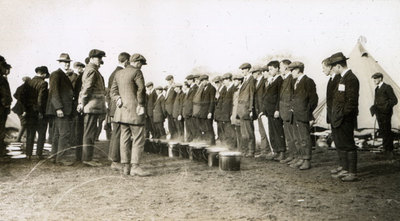 Men from the Pals Battalions observing buckets