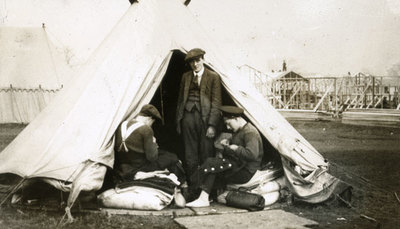 Men from the Pals Battalions in civilian dress in a tent at Heaton Park