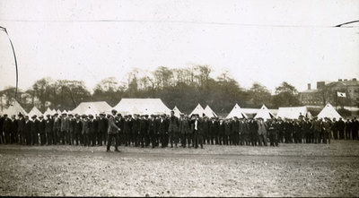 Men from the Pals Battalions assembled in front of tents at Heaton Park