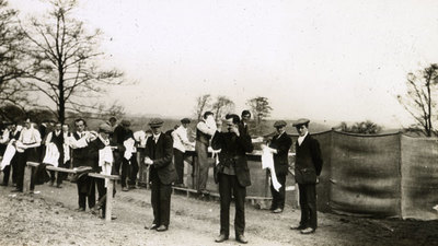 Group of men from the Pals Battalions washing outside in sinks at Heaton Park