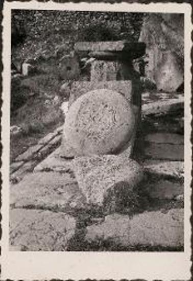 Delphi. Column base and round stones with carvings