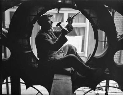 Worker repairing a window