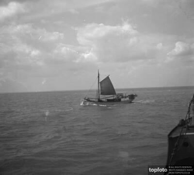 A Thames sailing barge crosses