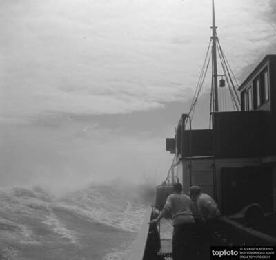 Steamship navigating through rough seas