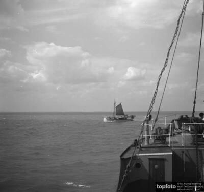 Ship passing a Thames sailing