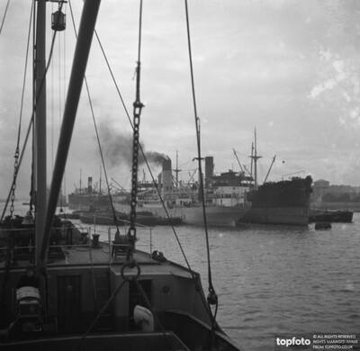 Merchant ships at dock on
