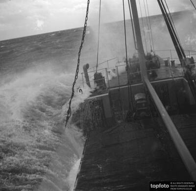 Ship is battered by waves