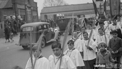 Choir boys carrying palm leaves