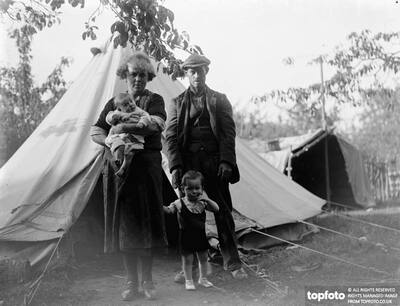 A gypsy family standing outside