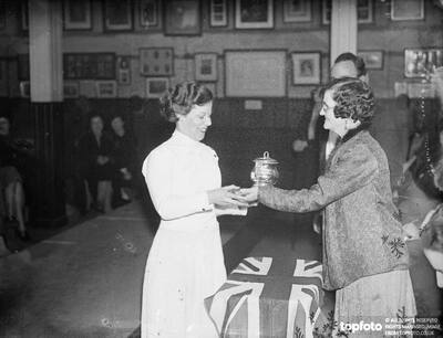 Madame Bertrand presenting the cup