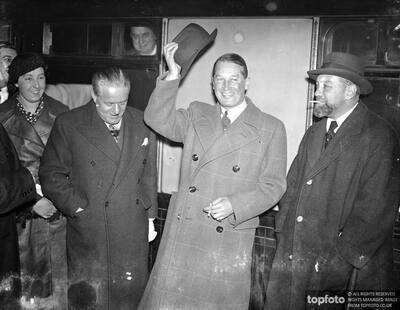 Maurice Chevalier arrives in London