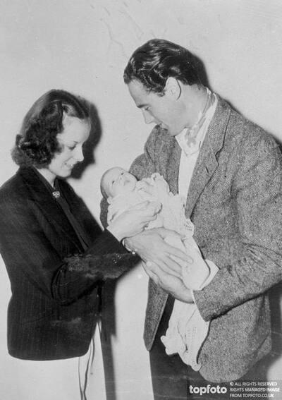 Patrick Knowles admires his baby